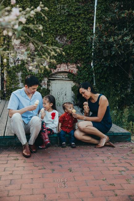 Family sitting together enjoying ice cream