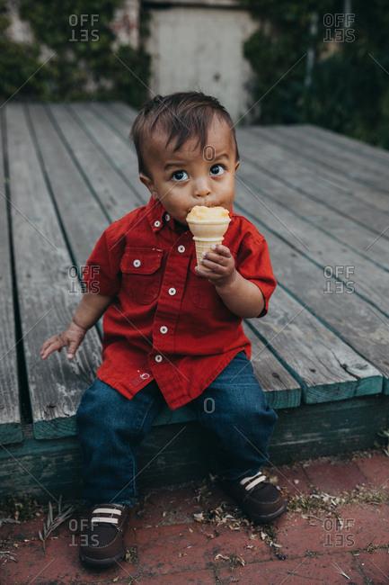 Toddler boy eating ice cream