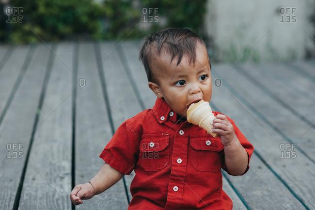 One year old boy eating ice cream