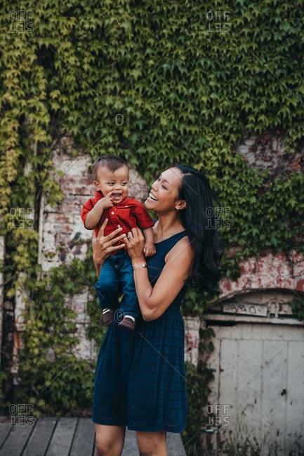 Mom holding toddler son