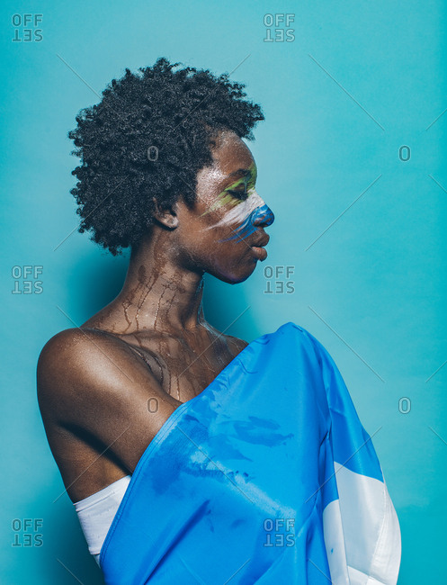 African woman wrapped in Sierra Leone county flag