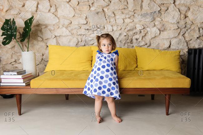 Cute little girl leaning back living room futon