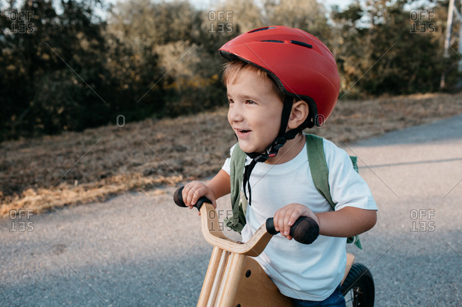 A portrait of a happy child wearing a bicycle helmet