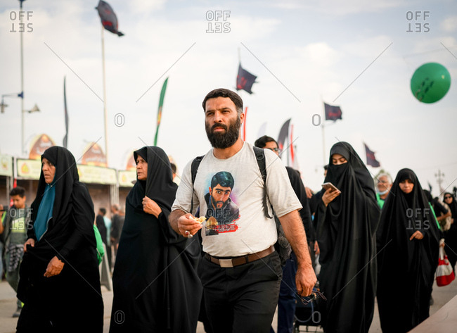 Karbala, Iraq - November 8, 2017: People walking on the Arba'een Pilgrimage to Karbala