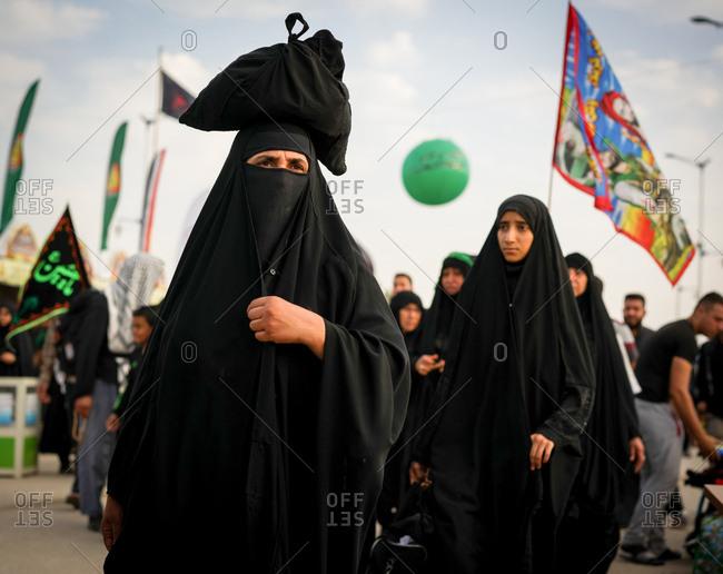 Karbala, Iraq - November 8, 2017: Women walking on the Arba'een Pilgrimage to Karbala