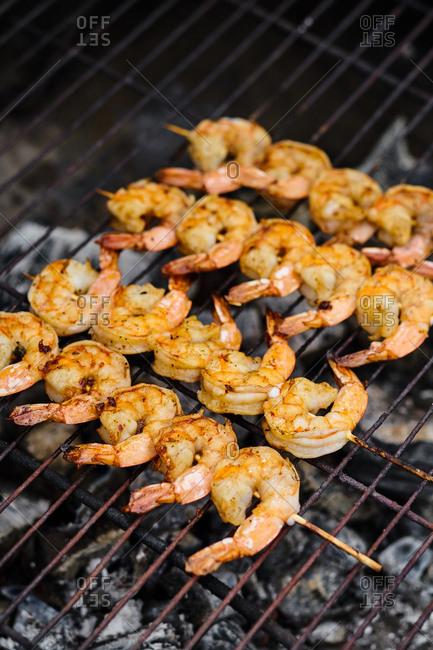 High angle view of shrimps on skewers grilling n the barbecue