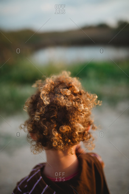 Back view of a girl with a curly hair