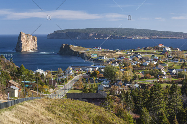 Canada, Quebec, Gaspe Peninsula, Perce, elevated view of town and Perce Rock from Rt 132