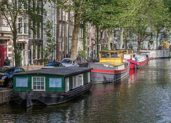 July 27, 2017: Houseboats on Raamgracht Canal, Amsterdam, North Holland, The Netherlands