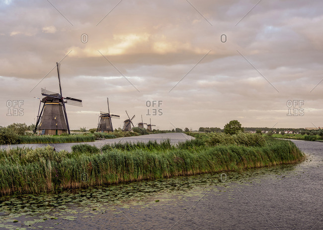 Windmills in Kinderdijk at sunset, UNESCO World Heritage Site, South Holland, The Netherlands