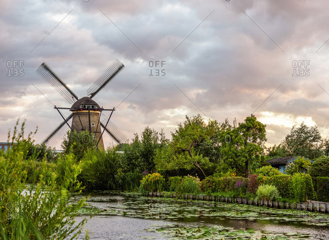 Windmill in Kinderdijk at sunset, UNESCO World Heritage Site, South Holland, The Netherlands