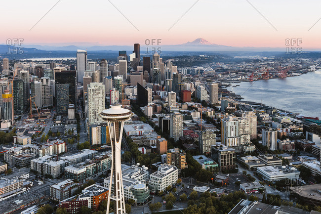 September 11, 2017: Aerial view of The Space Needle and downtown skyline at sunset with Mt Rainier in the background, Seattle, Washington, USA