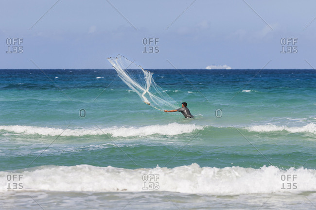 Havana, Cuba, North America - December 6, 2017: Man fishing in sea