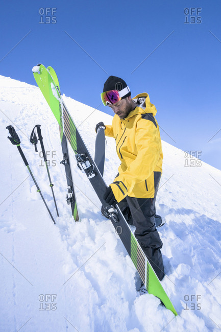 Man taking off ski skin, Bavaria, Germany, Europe