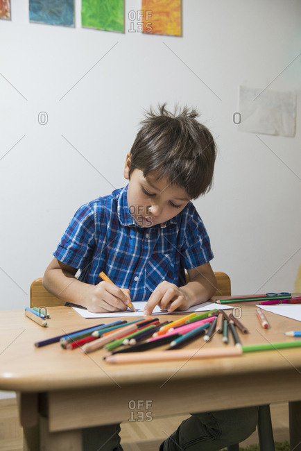 Boy coloring with colored pencils Munich, Germany