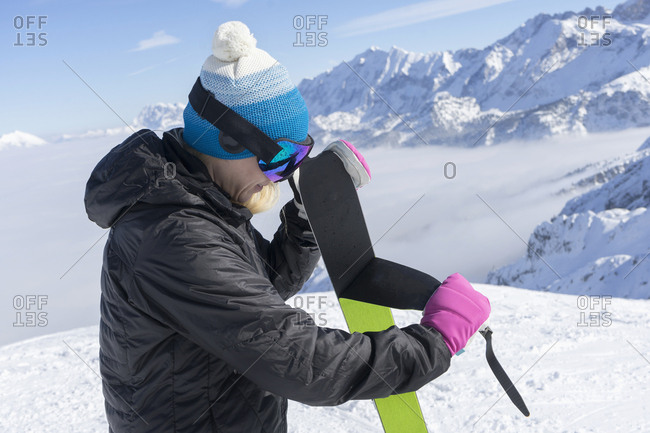 Woman skier taking off ski skin, Bavaria, Germany, Europe