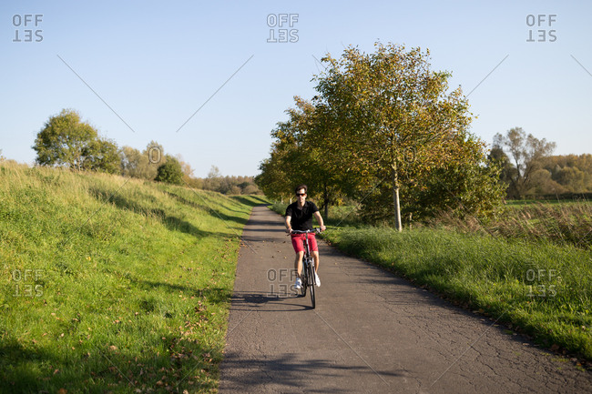 Man on bicycle trip in nature