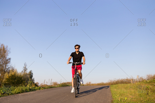 Man cycling on bicycle in nature