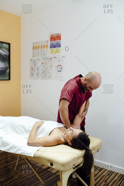 Woman enjoying a arm massage from a physiotherapist