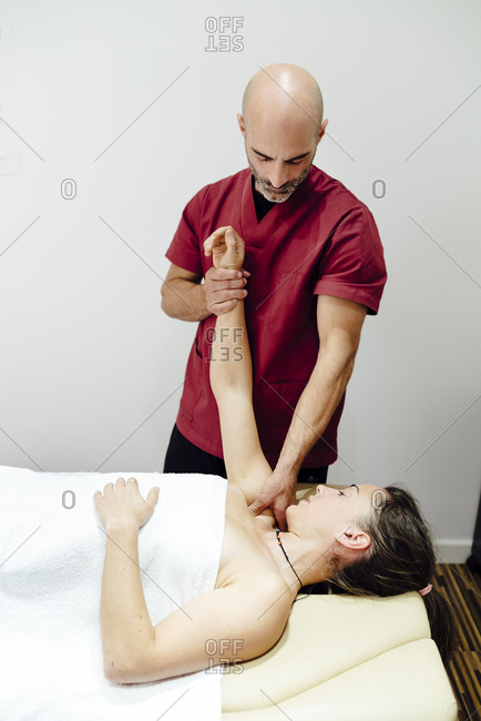 Woman enjoying a shoulder massage from a physiotherapist