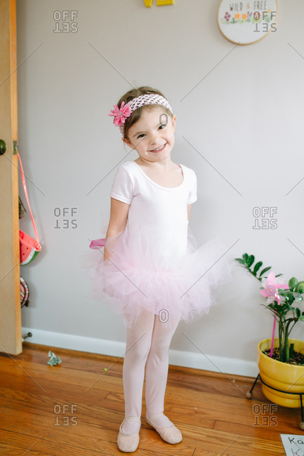 Cute ballerina posing in bedroom