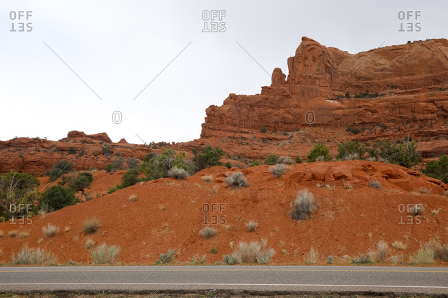 Red Valley, Arizona - April 28, 2018: Roadside lower angle view of secluded rocky formation