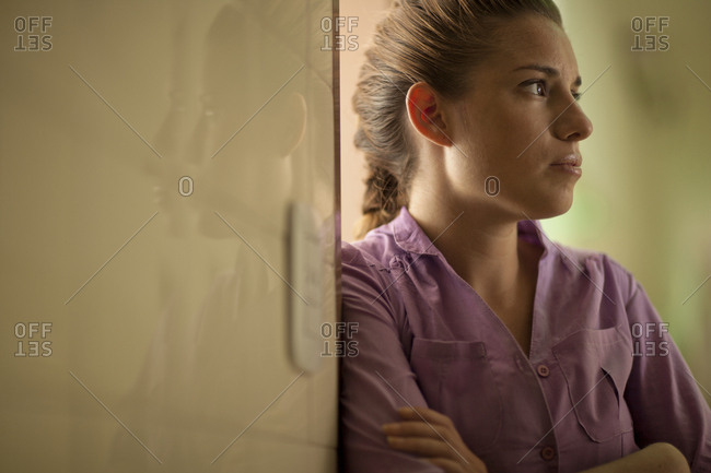 Mid adult woman anxiously waiting in hospital corridor