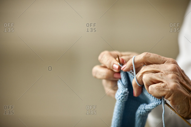Close-up of elderly woman's hands as she knits