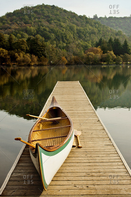 Canoe on a lake pier in autumn