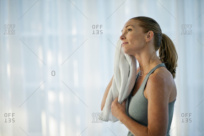 Happy mid adult woman drying off after a yoga class