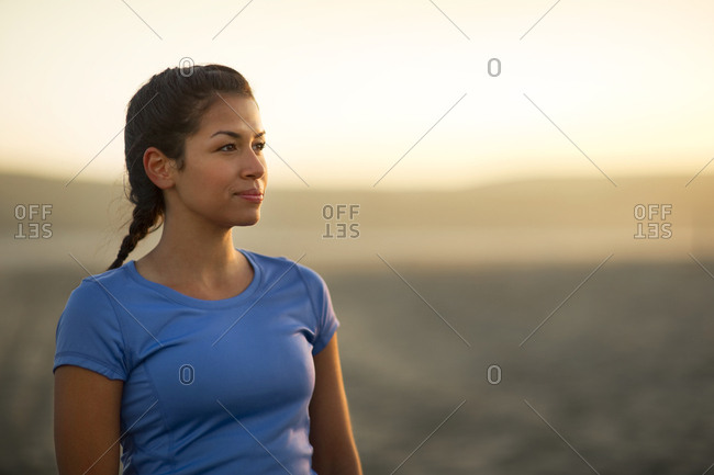 Thoughtful young woman at the beach