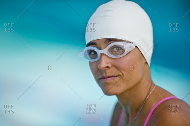 Portrait of a middle aged woman wearing swimming cap and goggles