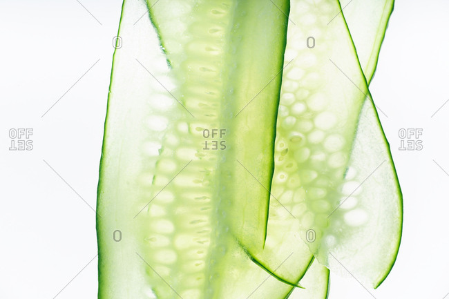 Macro shot of thin sliced cucumbers