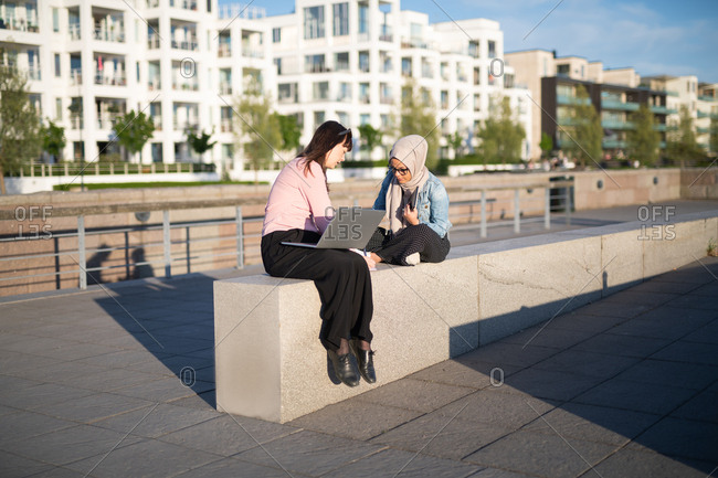 Two young businesswomen having an outdoor meeting