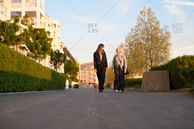 Young businesswomen walking together after work