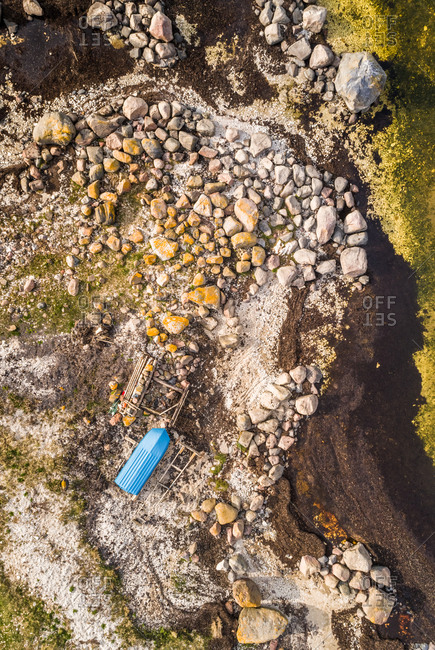 Aerial view of blue boat in abstract natural surrounding on the coastline of island of Vormsi in Estonia