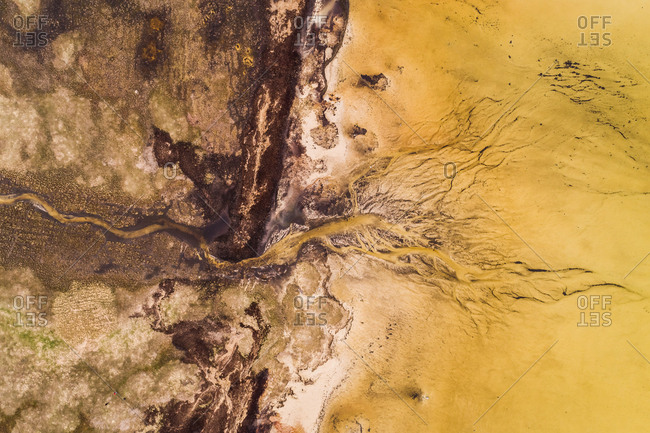 Abstract aerial view of algae bloom in sea on the island of Vormsi in Estonia