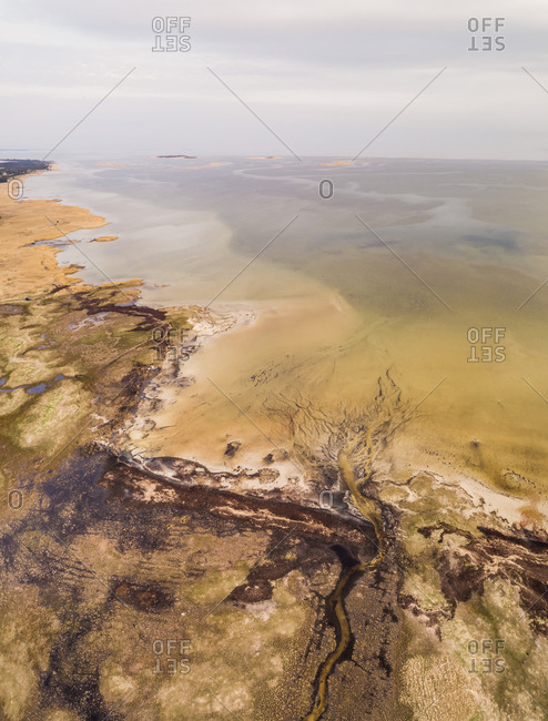 Aerial view of algae bloom in the sea on coastline of Vormsi island in Estonia