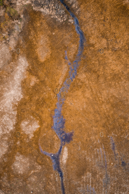 Abstract aerial view of narrow canal in wetland area in Estonia