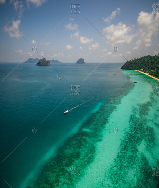 Aerial view of a boats in the paradisiacal sea in Chao Mai National Park in Thailand.