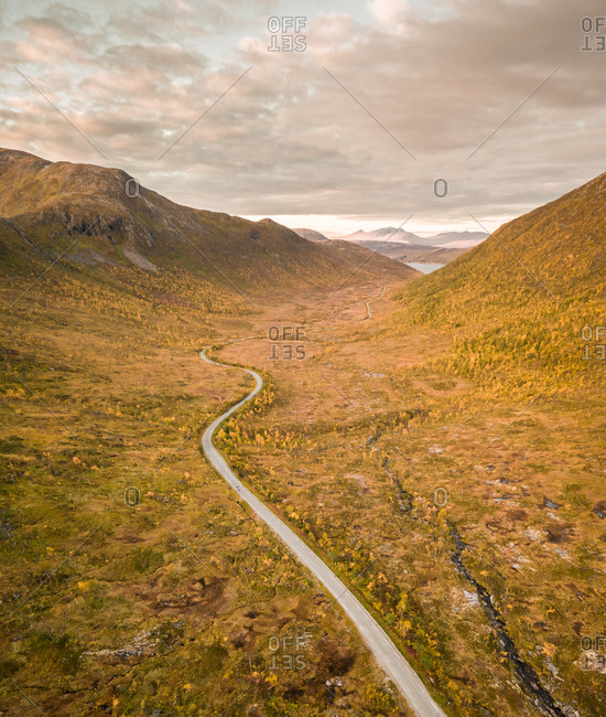 Aerial view of empty curvy mountain road in Norway.