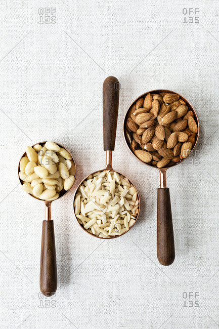 Almonds, raw, peeled and chopped in copper pans