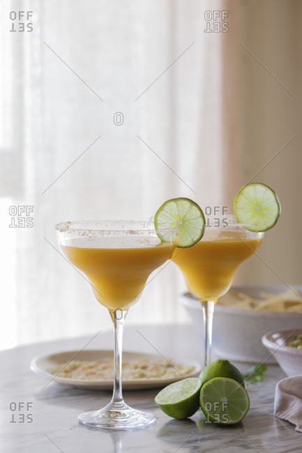 Mango Margarita with dips on a table