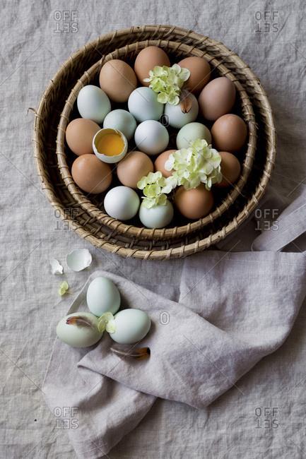 Multicolored eggs in a basket