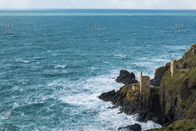 Botallack Crown Mines, view down onto ruined mine workings and wheel house on the cliffs, and view out to sea