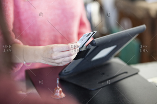 A closeup of a credit card being swiped in a credit card transaction