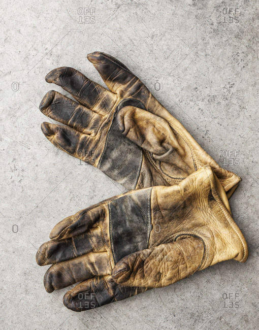 Close-up of a pair of used work gloves in a shop