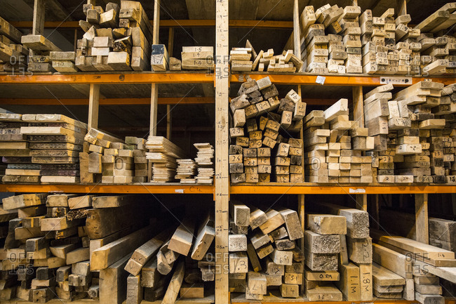 Large selection of wooden planks stacked on shelves in a warehouse