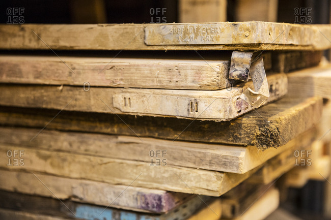 Close up of large selection of wooden planks stacked on shelves in a warehouse