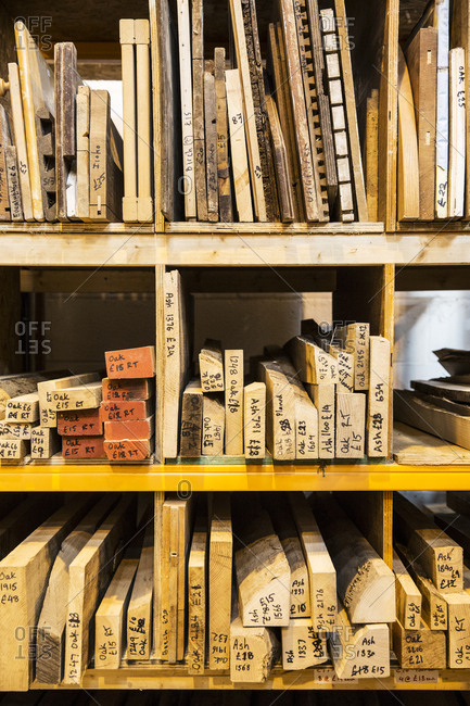 Large selection of wooden planks and boards stacked on shelves in a warehouse